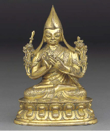 A Tibetan bronze figure of a L