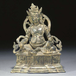 A Nepalese bronze seated deity