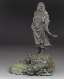 A Japanese bronze figure of an