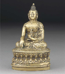 A Tibetan gilt bronze figure o