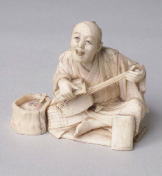 *A JAPANESE IVORY OKIMONO OF A