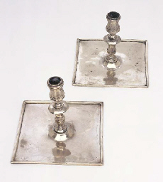 A PAIR OF SILVER TAPERSTICKKS