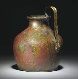 A GREEK BRONZE OINOCHOE