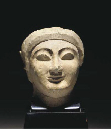 A CYPRIOT LIMESTONE HEAD FROM
