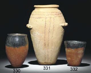 AN EGYPTIAN WAVY-HANDLED POTTE