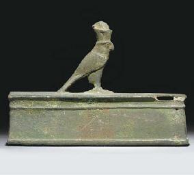 AN EGYPTIAN BRONZE FIGURE OF H