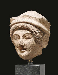 AN ETRUSCAN TERRACOTTA FEMALE