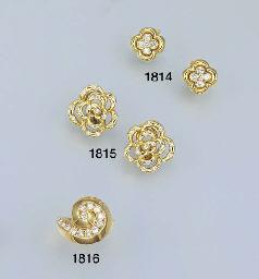 AN 18K GOLD AND DIAMOND