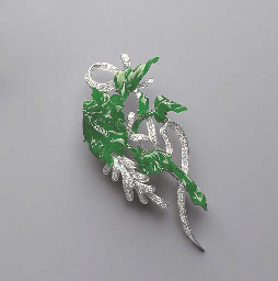 A CARVED JADEITE AND DIAMOND B