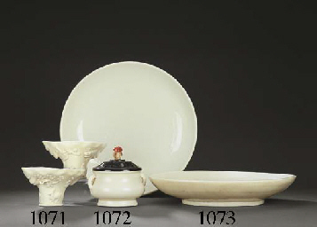A PAIR OF MOULDED DEHUA LIBATI