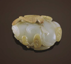 A WHITE AND BROWN JADE TOGGLE