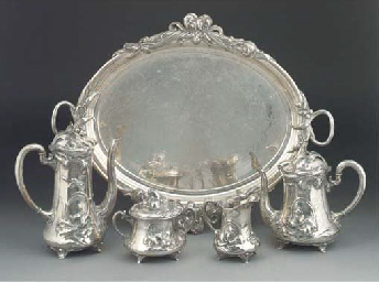 A SILVERED METAL TEA AND COFFE