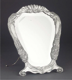 A SILVERED METAL TOILET MIRROR