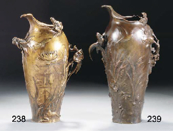 A PATINATED BRONZE TWIN-HANDLE