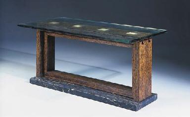 A PALMWOOD VENEERED TABLE