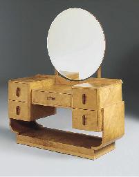 A WALNUT DRESSING TABLE