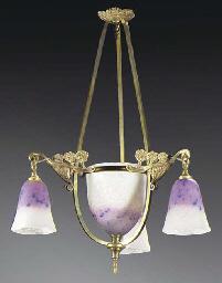 A mottled glass and gilt bronz