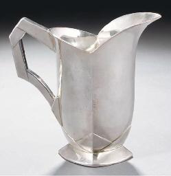 A silvered metal jug