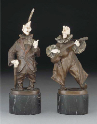 A pair of bronze and ivory fig