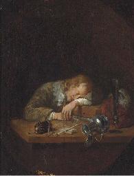 A man asleep on a table, in a