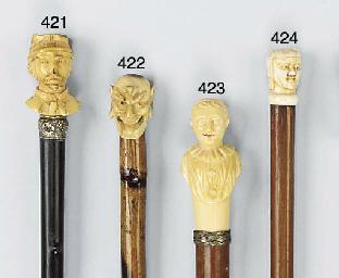 A carved ivory mounted ebony w