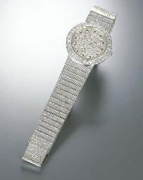 CHOPARD. AN 18K WHITE GOLD, DI