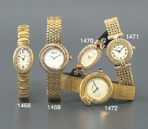 CARTIER. A LADY'S 18K GOLD WRI