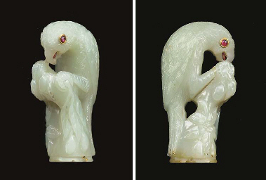 A CARVED PALE GREEN NEPHRITE K