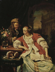 A man offering a glass of wine