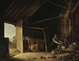 A barn interior with cattle an