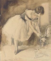 Dancer tying her shoe