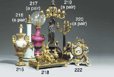 A French porcelain and brass m