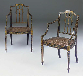 A pair of ebonised and painted