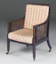 A mahogany and caned bergere