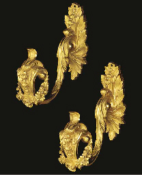 A pair of gilt bronze curtain