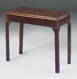 A MAHOGANY GAMES TABLE