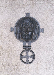 A bronze door knocker, the bac
