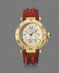 Cartier. An 18K gold self-wind