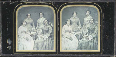 Four women, two seated and two