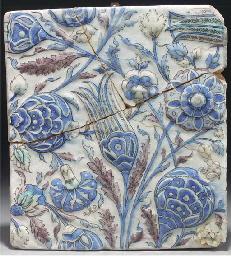 A Tehran moulded pottery tile,