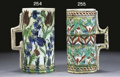 An Iznik cylindrical pottery j