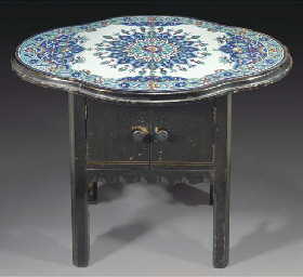A small ebonised wood table wi