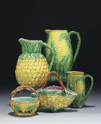 Five majolica jugs, two basket