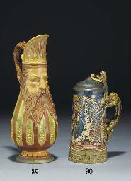 A Mettlach glazed stoneware pe