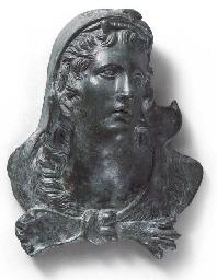 A GREEK BRONZE APPLIQUÉ OF HER