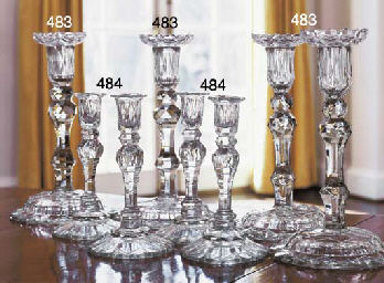 A SET OF FOUR CUT-GLASS CANDLE