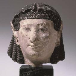 AN EGYPTIAN STUCCO MUMMY MASK