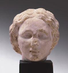 A ROMAN MARBLE HEAD OF A WOMAN