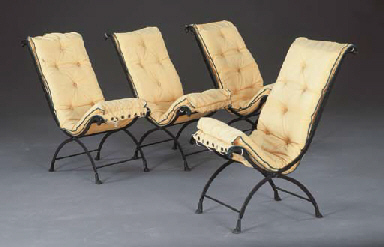 A SET OF FOUR WROUGHT-IRON SID