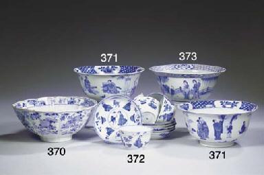 A set of six blue and white te